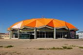 pic of bator  - A building with an orange geodesic dome in Ulan Bator - JPG