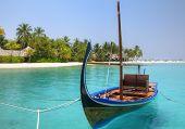 Gondola moored at Turquoise Lagoon on Maldive Islands