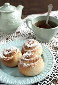 Fresh Sweet Homemade Cinnamon Rolls And Cup Of Tea