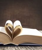 foto of bookworm  - Pages Of A Book Curved Into A Heart Shape - JPG