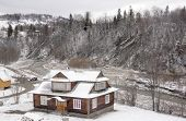 stock photo of zakarpattia  - Detached house near river in Carpathian mountains  in wintertime - JPG