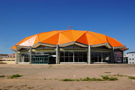 picture of geodesic  - A building with an orange geodesic dome in Ulan Bator - JPG
