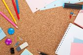 School and office supplies on cork wooden background with copy space
