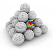 A pyramid of balls with puzzle pieces on them and one with colored pieces autism