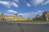 Louvre Museum And Pyramid By Day