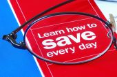Focus on learning how to save money everyday isolated on blue