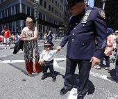 Little girl in NYPD uniform with father