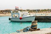 pic of bollard  - The yacht with the Egyptian flag docked at a pier in the Red Sea on a sunny daya mooring bollard on the pier