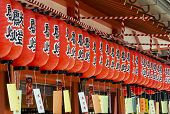 picture of impressionist  - Rows of red paper japanese lanterns hanging at a shinto shrine Kyoto Japan stylized and filtered to resemble an oil painting - JPG