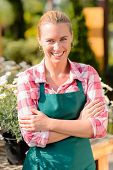 Garden center smiling woman worker wear apron portrait sunny day