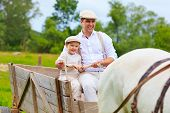 Father And Son Ride A Horse Cart