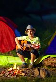 Boy Playing A Guitar Near Bonfire, Summer Camp