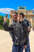 Man And Teen In Paris Take A Selfie In Front Of The Arc De Triomphe Du Carrousel