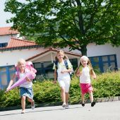 Three schoolchildren having fun