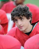 High school football player in huddle