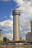 LONDON, UK - MAY 15, 2014   Building site with cranes in Canary Wharf aria  Raising new tallest resi