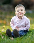 Young smiling caucasian boy on grass