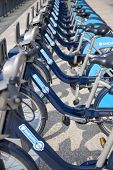 LONDON, UK - MAY 7, 2014: Boris bikes parking on business Canary Wharf aria, sponsored by Barkley's
