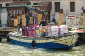 Service Worker Loads Into The Boat Bedclothes , Venice, Italy