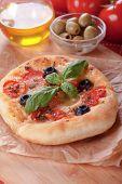 Italian focaccia bread with black olives and cherry tomato