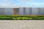 Shrubs With Zinc Fence On Blue Sky Background