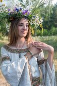 Young beautiful woman with flower wreath