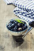 Fresh summer Blueberries on wooden background