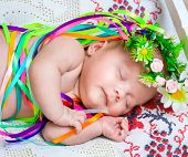newborn girl sleeping in the Ukrainian national costume