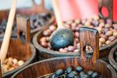 Sales of traditional products -Mediterranan olives- in the market