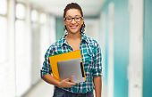 education, technology and people concept - smile female african american student in eyeglasses with folders and tablet pc