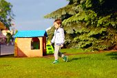 Boy Playing Near Toy House