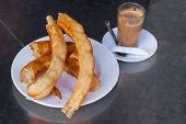 picture of churros  - Glass of coffee with churros  - JPG