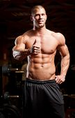 picture of half naked  - Portrait of super fit muscular young man working out in gym - JPG
