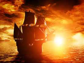 pic of pirates  - Ancient pirate ship sailing on the ocean at sunset - JPG