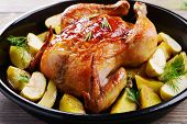 Delicious baked chicken on table close-up