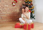 Happy Mother And Doughter Having Fun And Joy Of Christmas Time