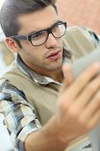 Portrait of young office worker with eyeglasses