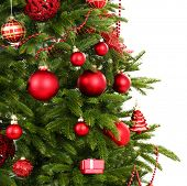 Decorated Christmas tree close-up isolated on white