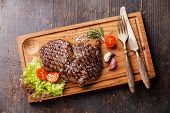 Medium Rare Grilled Beef Steak Ribeye On Cutting Board On Wooden Background