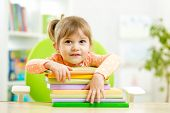Cute child girl preschooler with books