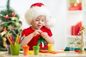 child making by hands christmas decorations