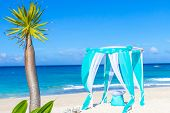 beautiful wedding arch on tropical sand beach, outdoor beach wedding set up