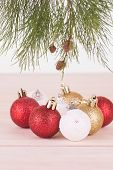 Red, Whte And Gold Christmas Baubles And Pine Tree Branch