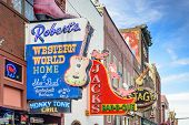 NASHVILLE, TENNESSEE - JUNE 14, 2013: Honky-tonks on Lower Broadway. The district is famous for the numerous country music entertainment establishments.