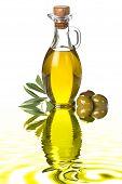 Bottle Of Virgin Extra Olive Oil And Olives