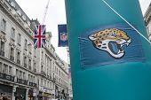 LONDON, UK - SEPTEMBER 27: Jacksonville Jaguars banner and NFL flags above in Regent Street. September 27, 2014 in London. The street was closed to traffic to host NFL related games and events.