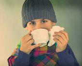 ill boy drinking hot tea