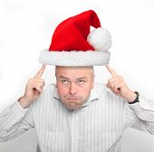Funny picture of an man with reindeer antlers and christmas decoration.