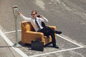 scene of businessmen who parks his armchair and pay the parking