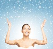 Portrait of young and beautiful teenage winner girl over winter background